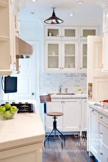 vintage classic kitchen.  marble + glass front cabinets + white + walnut