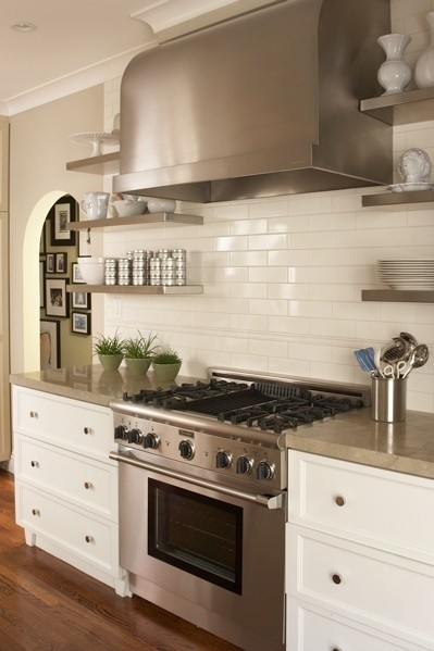 Subway tiles with matching grout, cabinets, stainless steel and neutral counter