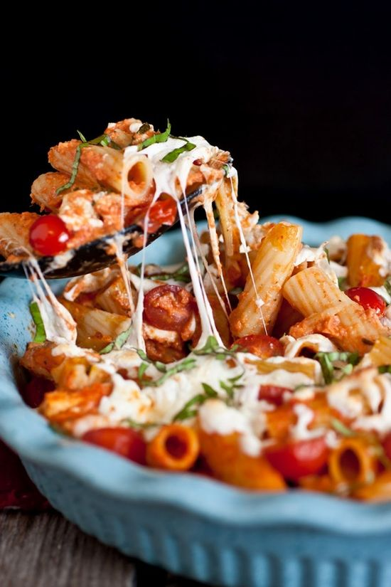 grilled chicken caprese pasta with garlic, romano, mozzarella, and fresh basil.