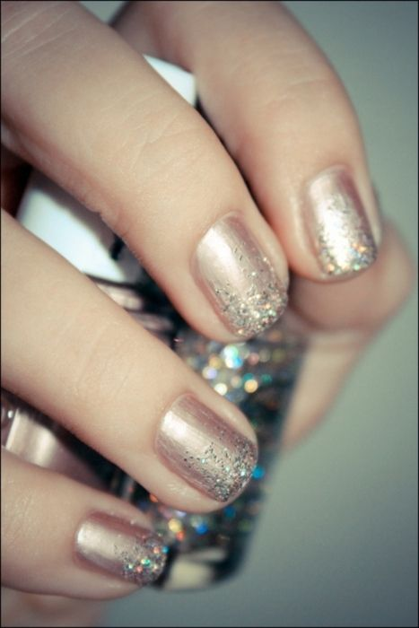 Neutral nail with glitter on the tips.
