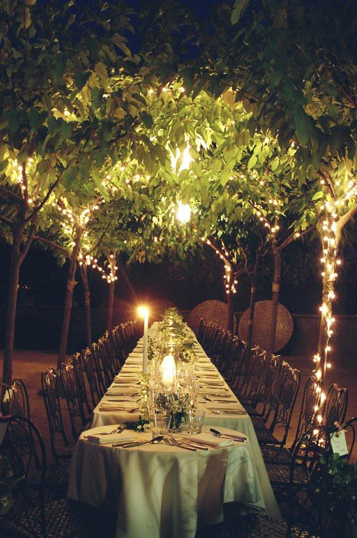 Outdoor table setting for an evening summer wedding, how romantic!