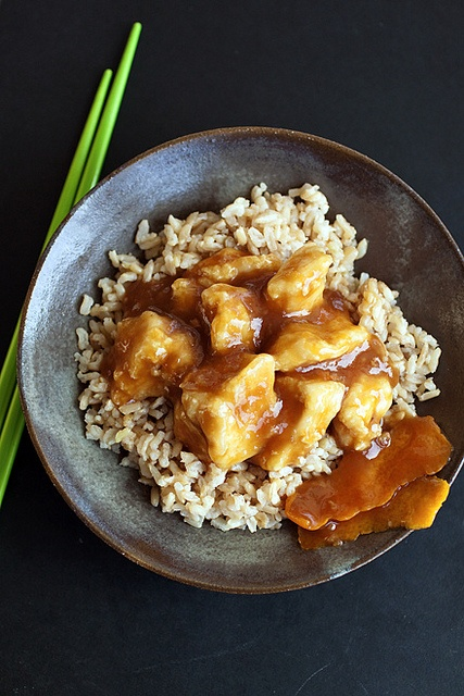 Wonderfully zingy, delicious classic: Orange Chicken over Brown Rice. #rice #Asian #orange #chicken #dinner #meals #brown #food #cooking #delicious