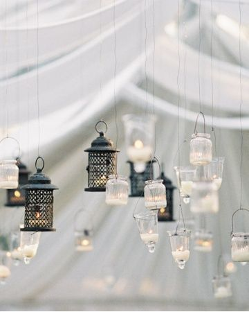 Dozens of hanging lanterns—each chosen for their rustic, vintage feel—illuminated this reception tent