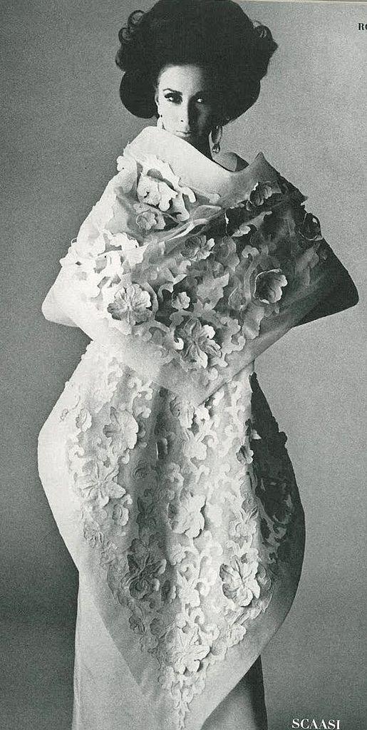 Wilhelmina is wearing Scaasi's exquisite white silk organdie handkerchief dress and shawl, photo by Penn for Vogue, 1965