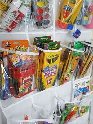 Use an over-the-door shoe organizer to hold craft supplies in a playroom.