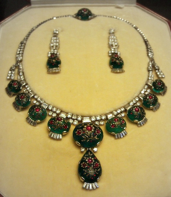 Necklace and earrings    British Museum  Cabochon emeralds inlaid with ruby and diamond.  Cartier London 1937