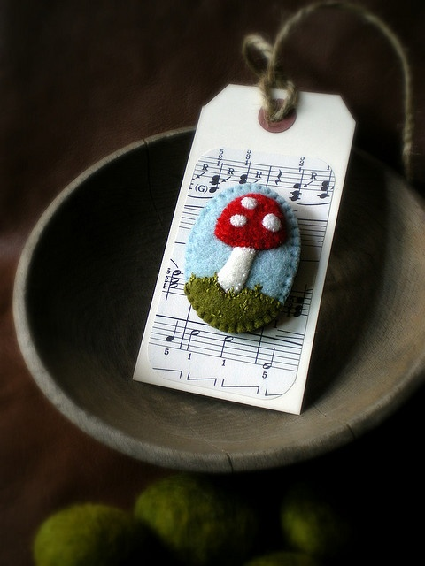 A fun way to give a hand made gift - attached to a tag (embroidered felt pin)