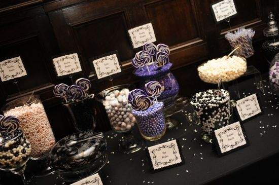 "Not exactly what we're doing, but something about the candy table makes me very happy.  ""A creepy and elegant gothic wedding"