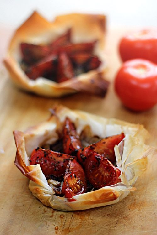 Rustic Caramelized Onion and Tomato Tartlets by emilylovesfood: Light and easy with store bought filo pastry. #Tomato_Onion #Tarte #emilyloves food
