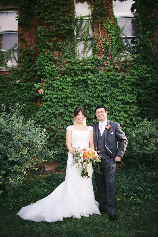 Wedding photos in front of ivy wall