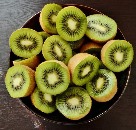 kiwi - great source of dietary fiber, potassium, & vitamins E, C, and K.
