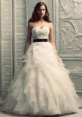 ball gown with ruffle skirt, I like how the black band separates the two.