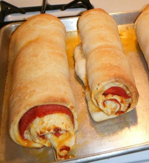 Dawn this is what i want for my bday dinner but not just proeroni Pizza Bread rollup, then slice as thick as you like