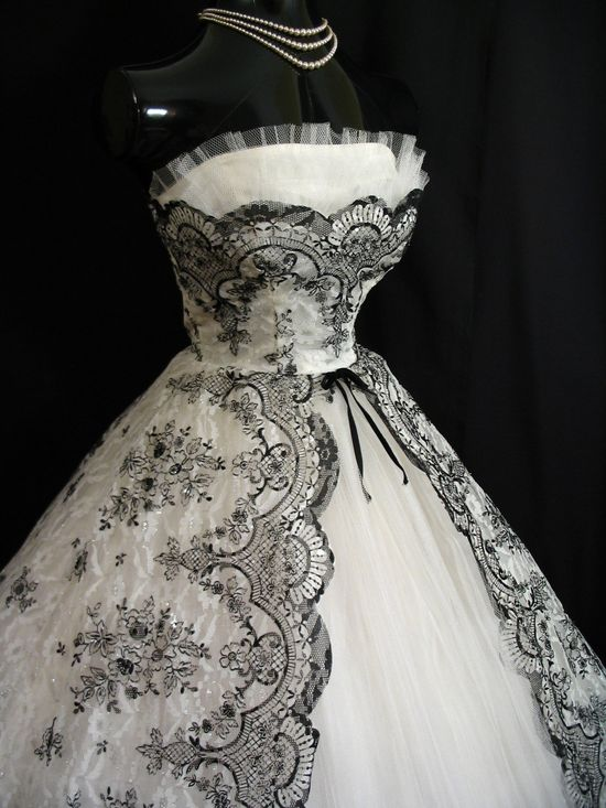 1950s dress with black floral lace.  I love the designs.