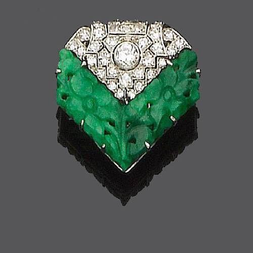 An art deco jade and diamond lapel brooch, circa 1920