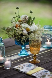 Lovely aqua glass used as a centerpiece vase...nice golden goblet, too!