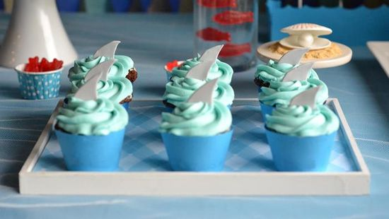 Shark cupcakes at a Under the Sea Party with Lots of Cute Ideas via Kara's Party Ideas