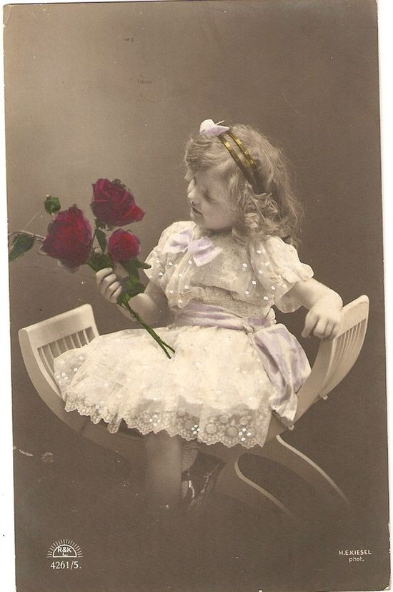 vintage postcard young girl with roses