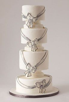 Romantic wedding cake with ribbons and bows. #weddings #weddingcakes  Cake by Lulu Cake Boutique