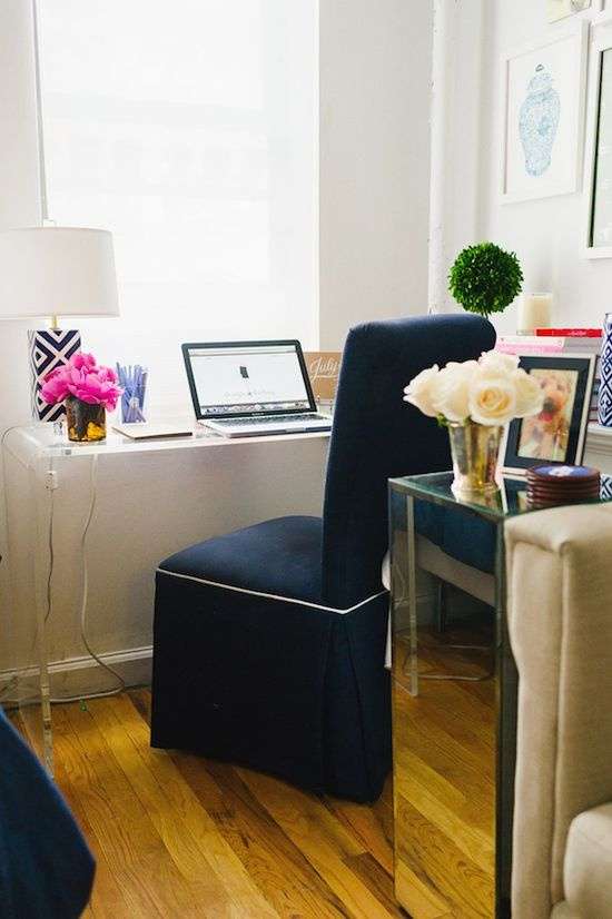 """Glitter Guide At Home: Mackenzie Horan Of Design Darling 300 square foot apartment, NYC apartment, studio apartment, NY apt. """"The Society Social Piper bow chair is probably my favorite piece in the apartment. The designer Roxy is a good friend of mine and her line just keeps getting better! The acrylic console-turned-desk is CB2, the lamp is Mary MacDonald and the monogrammed pencil cup is Design Darling."""""""