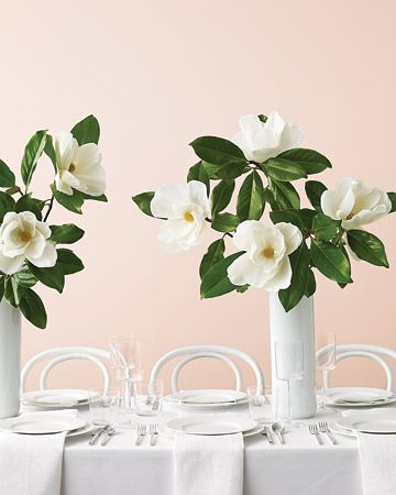 Paper magnolias are a wilt-free way to incorporate these beautiful harbingers of spring into an eye-popping centerpiece. #MarthaStewartWeddingsMagazine