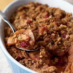 Apple-Cranberry Walnut Crisp.  A healthful dessert with apples, cranberries, cinnamon, apple cider, maple syrup with a topping of oats, walnuts & whole wheat pastry flour.  I'd use coconut oil in place of the butter.