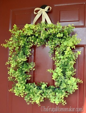 Spring wreath made from greenery and an old picture frame.  Love square wreaths!
