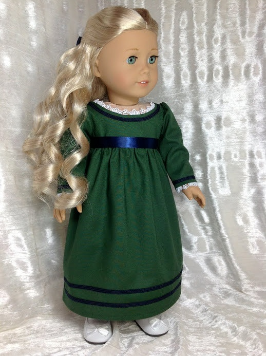 """Caroline's green dress from the book cover """"A Surprise for Caroline"""" made in green Moda cotton with blue trim. $69.00, DollSizeDesigns via Etsy."""
