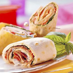 Roast beef, roasted red peppers, and fresh basil leaves make this hearty wrap great for lunch at the office or to take to a tailgate in the fall.