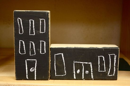 Chalkboard paint on wooden blocks so your kid could create their own town - so cool!