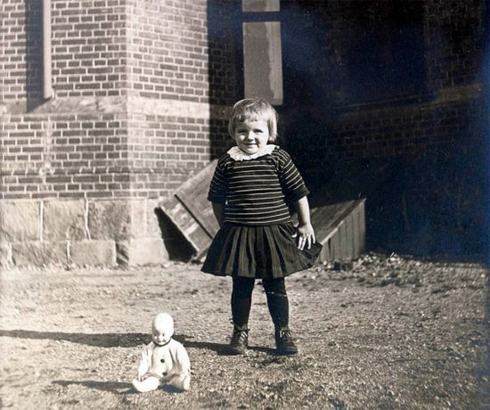 Cute Swedish girl with her doll, circa early 20th c.