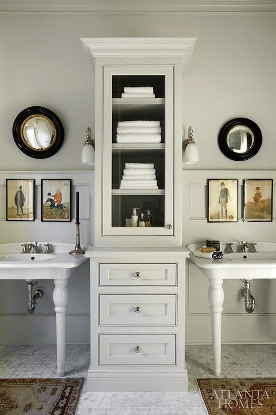 double pedestal sinks with tall cabinet in between for storage. #bathroom decorating before and after #bathroom decorating #bathroom design