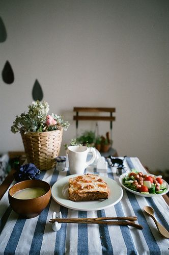 breakfast  morning trifecta: toast, wooden utensils, striped tablecloth