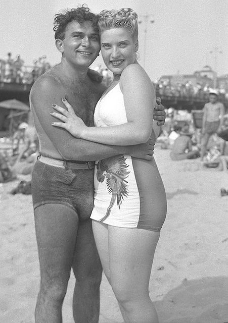 Love her braided updo and that great two-tone swimsuit. #vintage #beach #couple #woman #man #swimsuit #1940s