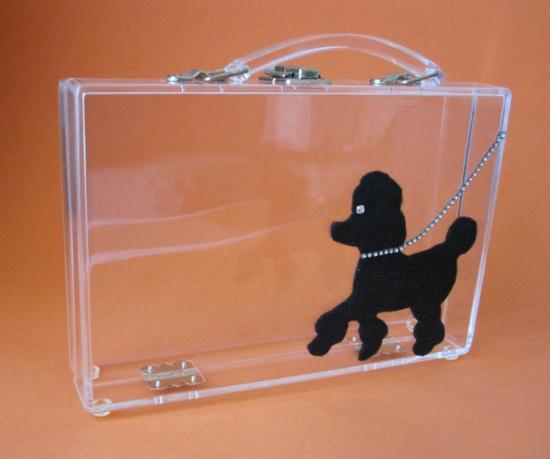 A darling 1950s clear handbag with black poodle detail. #vintage #1950s #purses #handbags #poodles