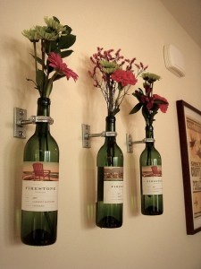Wine bottle flower vase sconces.  Now i have something to do w/all those empty bottles...