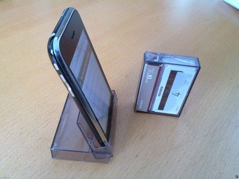 Empty cassette tape case > iPhone stand.