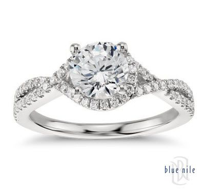 Capture your lasting love with this stunning 14k white gold engagement ring that showcases an elegant drape of pavé-set diamonds around your center stone and along the twisting shank for a captivating look. #BlueNile