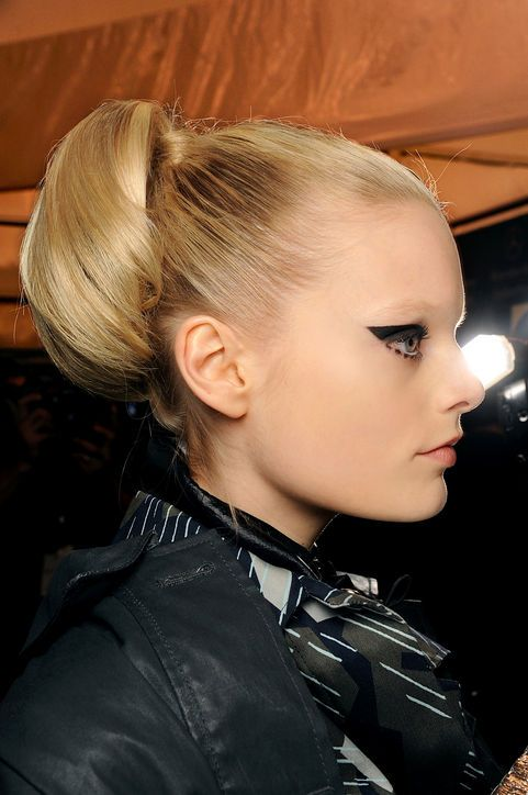 bun.  Holiday Hairstyle Idea for an Office Party: Pull It All Up  The grade school-style curled ponytail has been sleekified. Something about the easy-going-ness of this look at Anna Sui feels like a fun night guaranteed.