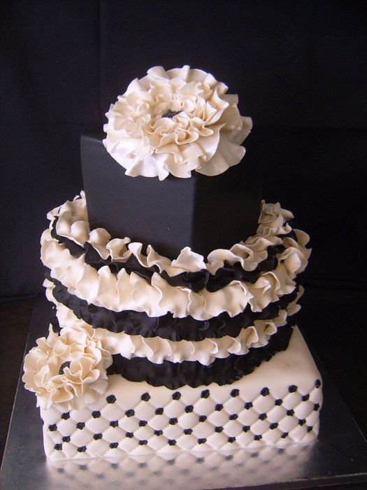3 Tier black and cream cake with rose petals, flowers and quilting. - by aneesa @ CakesDecor.com - cake decorating website