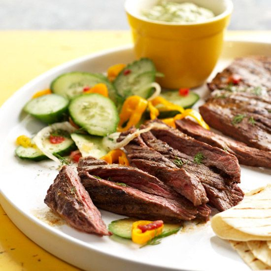 This Spicy Skirt Steak with Avocado Dipping Sauce makes for a refreshing summer dinner. More of our best grilled steak recipes: www.bhg.com/...