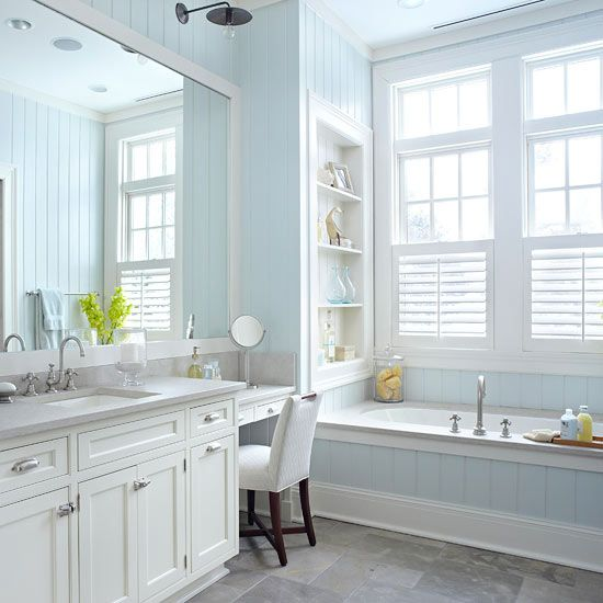 Pretty, Peaceful Bathroom    Tongue-and-groove paneling wraps this master bathroom with a sophisticated cottage look that is a bit more refined than casual beaded board. The soft blue paint color and cool limestone countertops reflect the home's lakeside setting and set an ambience of relaxation.