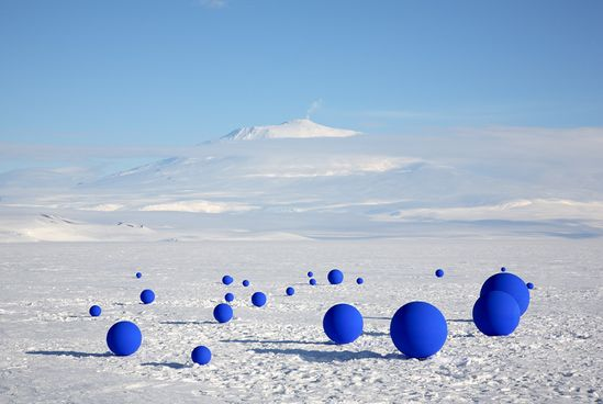 California-based artist lita albuquerque led an expedition to antarctica to create 'stellar axis', an art installation with 99 blue spheres placed on the ice in corresponding locations to specific stars in the sky above.