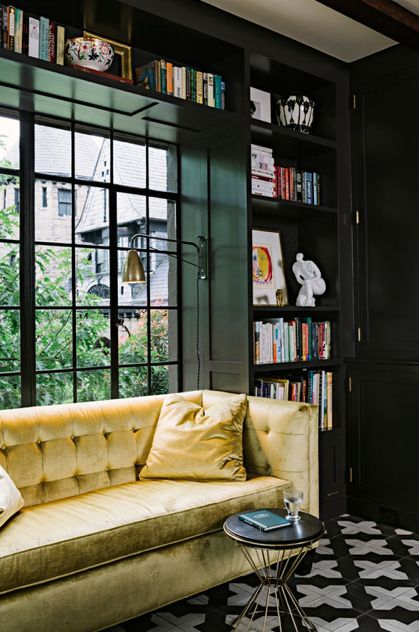 Beautiful black shelving. Goes great with the golden couch.