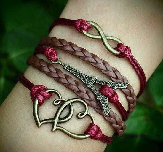 Leather & red bracelets, cute Eiffel Tower #Paris #jewelry #bracelets