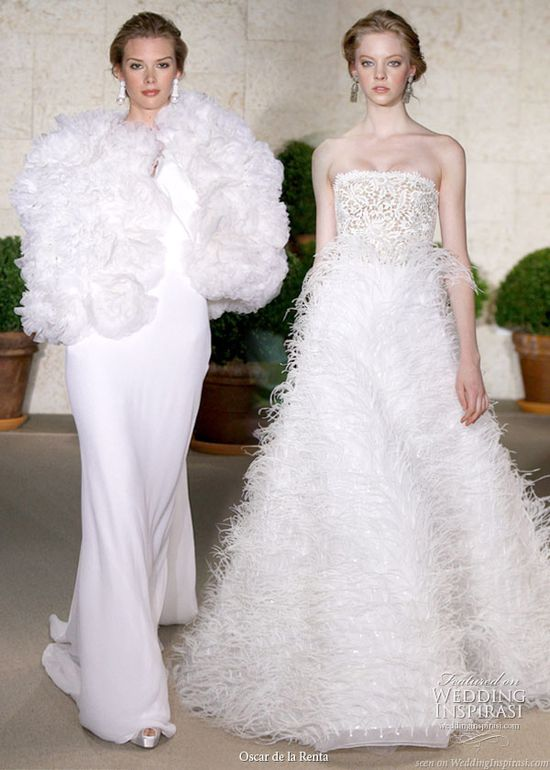 Wedding dresses with two different silhouettes from Oscar de la Renta Spring 2011 bridal collection - sleek sheath with large ruffle stole cape and a-line feather skirt