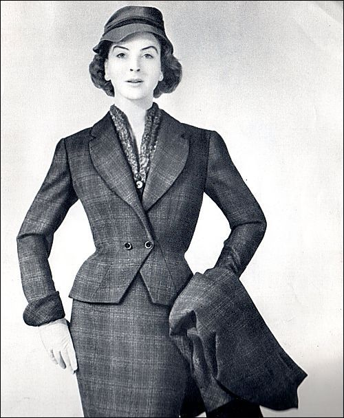 A sophisticated plaid skirt suit with matching overcoat from 1954. #vintage #1950s #fashion #suits #fall #winter