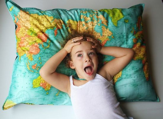 Vintage world map pillow made with organic cotton.