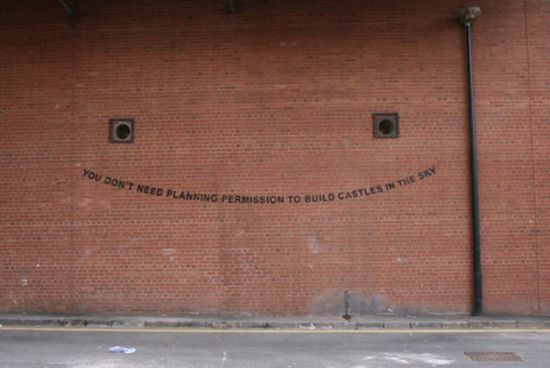 """You don't need planning permission to build castles in the sky"" graffiti"