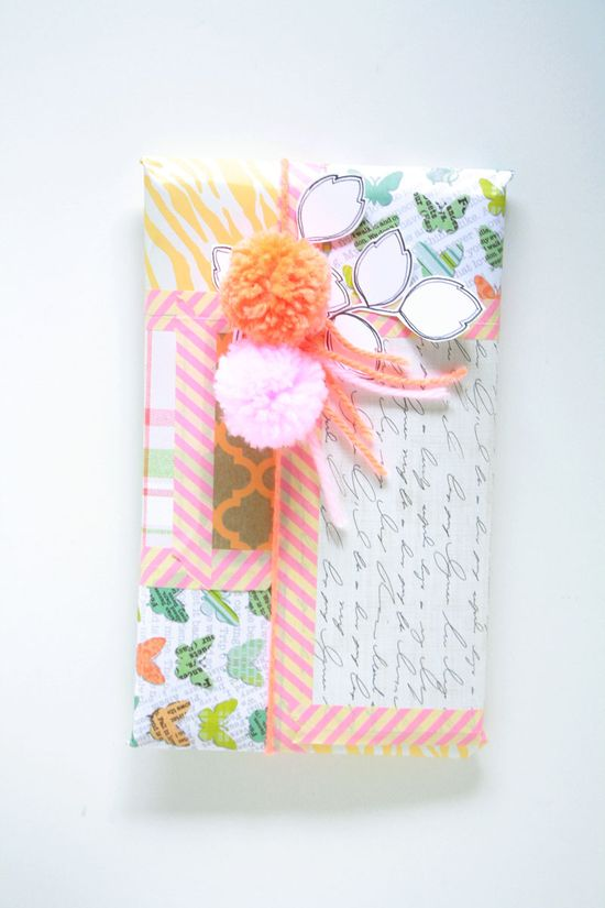 mix of prints & papers + washi tape to put them together + yarn pom poms